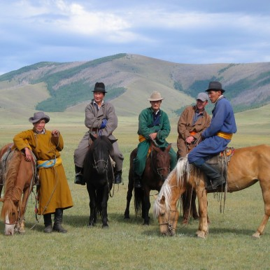 Mongolian horse men (c) Mark Johnstad