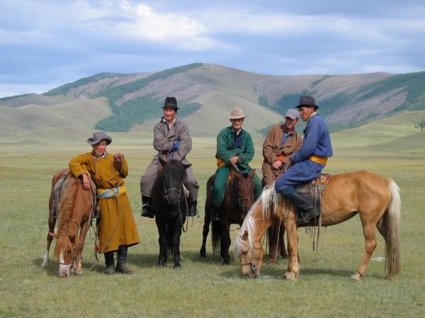 Mongolian horse men (c) Mark Johnstad