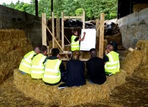 Bee explaining straw bale building, Rock Farm Slane